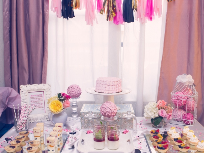 dessert table with tissue garlands